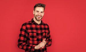 man smiling red shirt