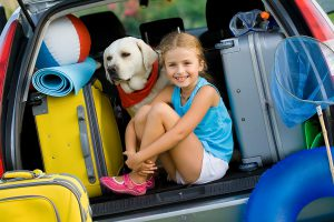 Travel, tourism - Girl with dog ready for the travel for summer